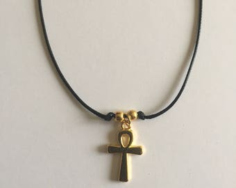 Cross on black wax cord