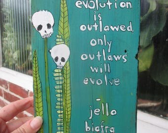 Jello Biafra quote art, if evolution is outlawed only outlaws will evolve, skull flowers, punk rock art, evolution quote,  Dead Kennedys