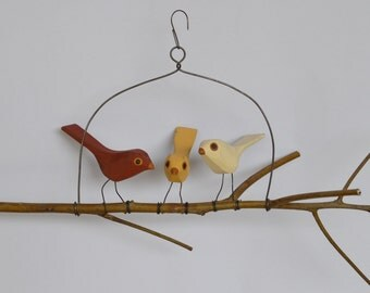Three hand carved folk bird branch swing