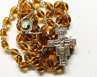10mm X 6mm honey glass oval bead rosary with enamel Padre Pio Sacred Heart center and San Damiano crucifix