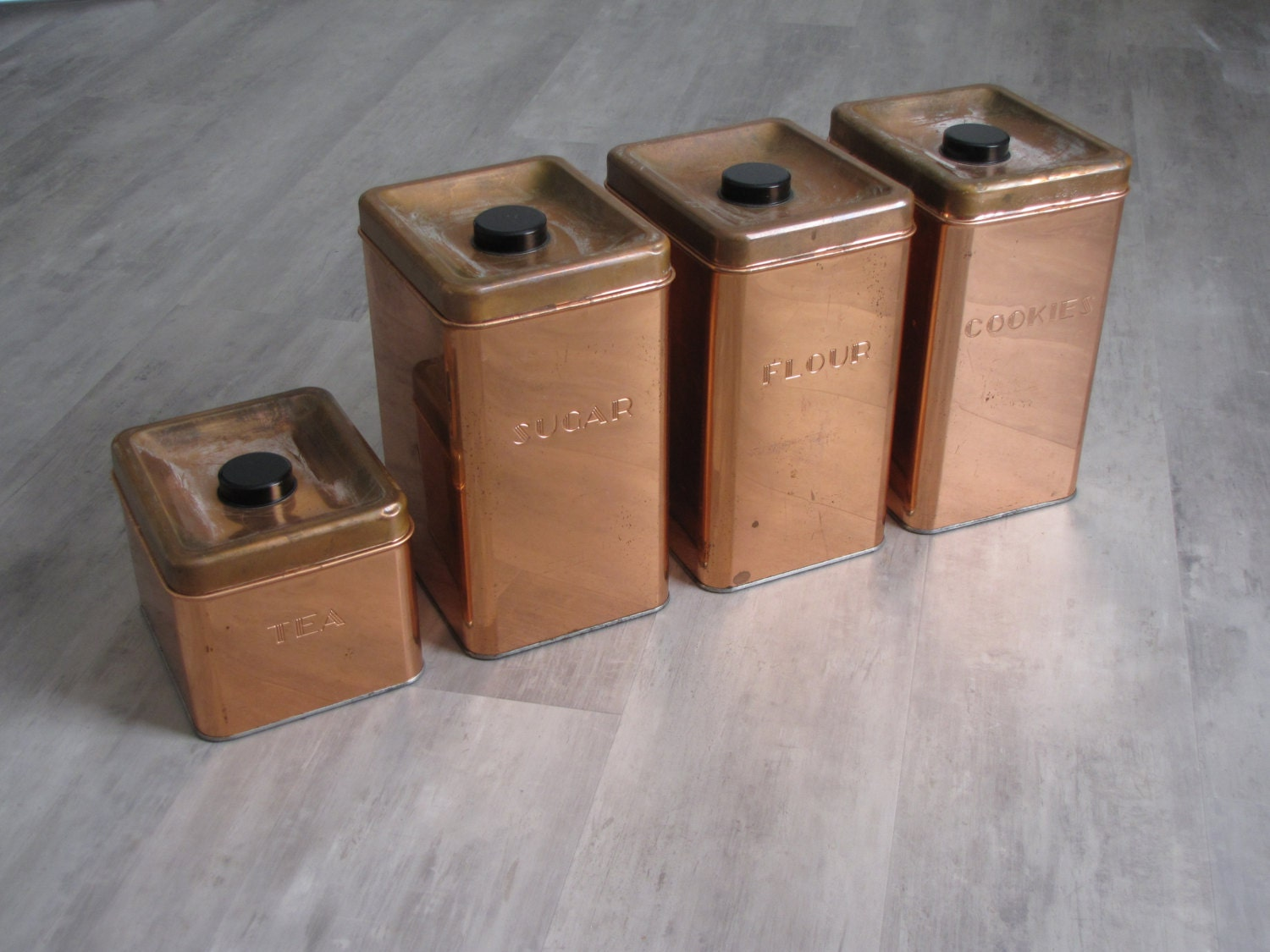vintage copper look canisters flour sugar cookies and tea