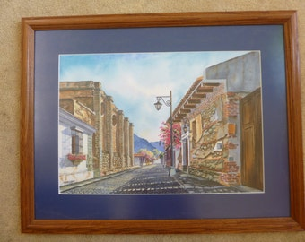 Framed water color of a street in the city of Antigua, Guatemala.