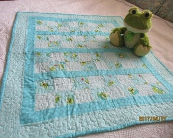 child's quilt  Freddie Frog & Friends  Happy little frogs hopping on to lilly pads.