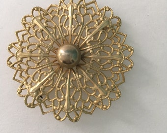 1950s goldtone ruffled round filigree brooch pin gold tone lacy costume jewelry elegant