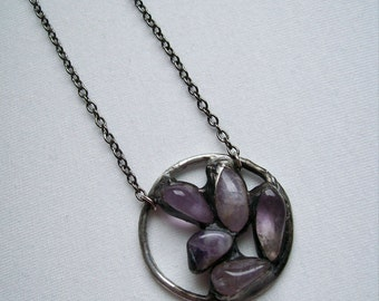 Amethyst pendant made according to Tiffany technique