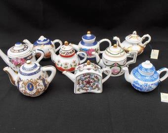 Porcelain Art Miniature Tea Pot Collection. Set of Nine