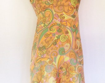 Vintage multicolor silk gown with geometric swirl design. Sleeveless with cape flaps at shoulder, empire waist and flared skirt