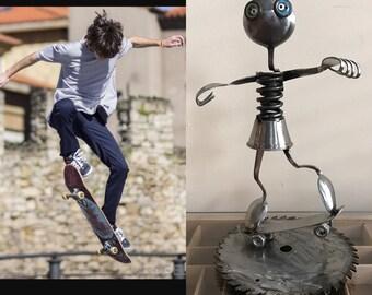 found object robot skateboard sculpture assemblage metal sculpture