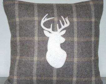Plaid wool cushion with stag appliqué