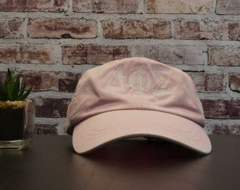 Delta Phi Sigma Pale Pink The Dad Hat - 6 Panel Low Profile Pigment Dyed Cap with White Embroidery