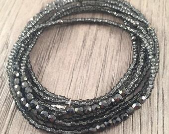 6 strands of grey stacking stretch bracelets