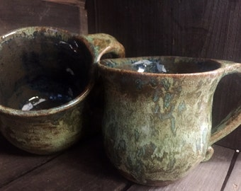 Set of 2 handmade wheel thrown coffee mugs in a green and brown swirled glaze