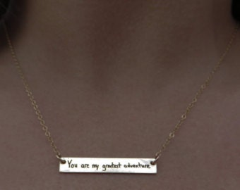 We wish we had a picture of her actual necklace, but this is the listing she choose from.