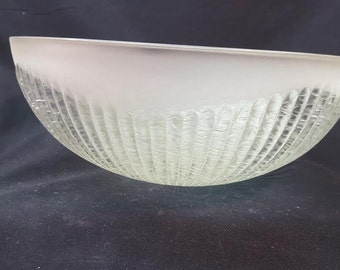 Clear glass  with ribbed ice texture , center post mount dome with  frosted edge .   10 inch diameter