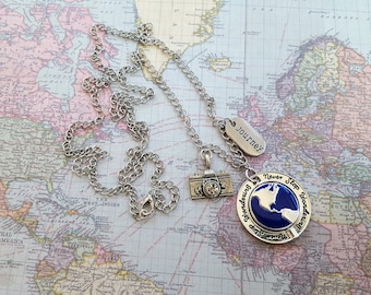 """Travel Necklace """"Never Stop Wandering"""" Pendant Swivels to Other Continents, Camera, """"Journey"""" Tag on 33"""" Silver Link Chain & Lobster Clasp."""