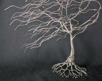 Awsome looking stormy wire tree is free standing 11 inches tall with Purple Pink springtime bloom beads. Sculpture #170317