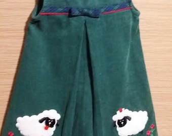 Cutest little green sheep dress, With two little white sheep.