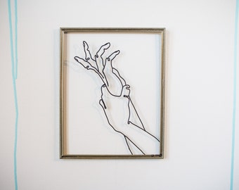 HANDS GRASPING wire sculpture