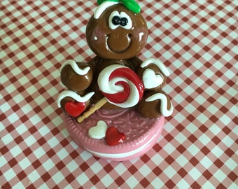 Gingerbread Man with Lollipop sitting on an Oreo