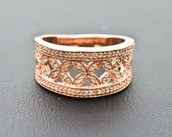 Sterling Silver/Rose Gold Overlay 0.25cttw Genuine Diamonds Ring size 6 weighing 3.7g