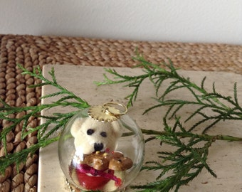 Death by Gingerbread Man. Cute Little Bloody Beige Teddy Bear Head has been preserved in a glass ornament. Creepy. Cute. Unique. Handmade.