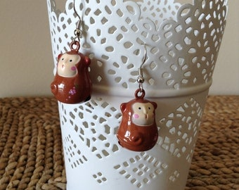 Monkey Bell Dangle Earrings. Baby you can ring my bell anytime. Metal. Lightweight. Unique. Super fun!