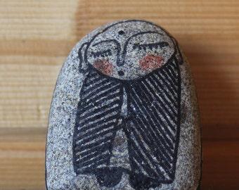 Jizo painted in stone.
