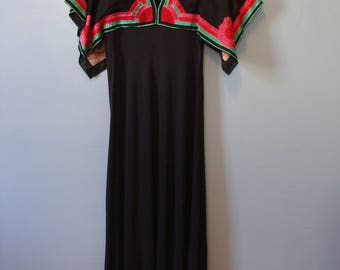 Janice Wainwright at Forty Seven Poland Street England 70's Iconic Embroidered Maxi Dress Art Deco Flowers Colorful Jersey Sheer Sleeve Boho