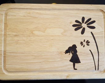 "Little girl with flowers pyrography chopping board. 12""x8"""