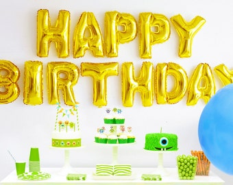 "Happy Birthday Balloons. Happy birthday sign in gold letter balloons. 16"" (16 inches) Gold foil / mylar letters for a birthday party banner."