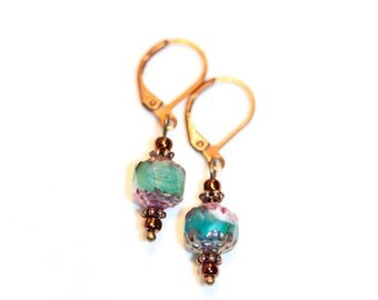 Earrings with 8 mm green glass beads and dark copper elements