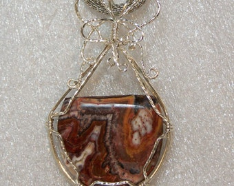 Natural Petrified Wood Pendant wire wrapped in a basket of sterling silver wire, fossil wood, brown black white tan petrified wood.