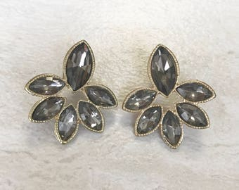 Black diamond gems and gold stud earrings