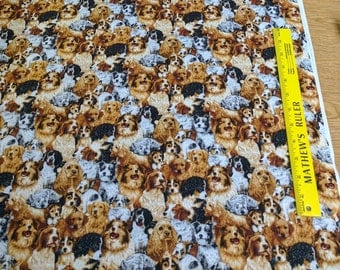 Stacked Dogs Cotton Fabric from Fabri-Quilt