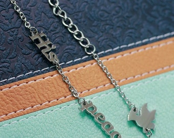"""Christian stainless steel bracelet chain with the words """"His peace"""" and a small dove"""