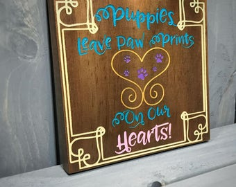 Puppies Leave Paw Prints on Our Hearts - Wooden Wall Hanging