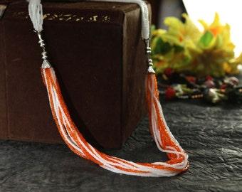 orange and white necklace