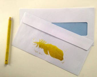 Lino printed envelope, feather