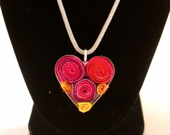 Silver heart pendant with fuschia and yellow wool