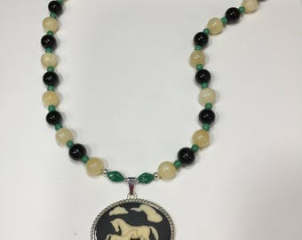 Mare and foal cameo necklace