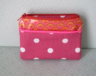 Pink wallet and peas