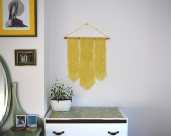 Yellow geometrical macramé wall hanging