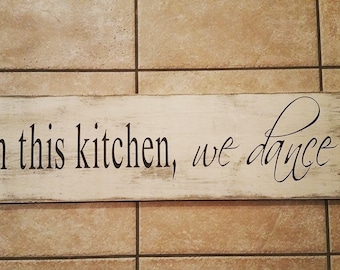 In this kitchen, we dance sign