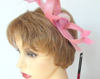 Merry fascinator in pink sinamay bow with pearl