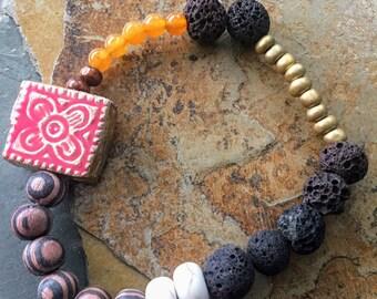 Dark Brown Lava Bead and Salmon/Gold Charm Bracelet