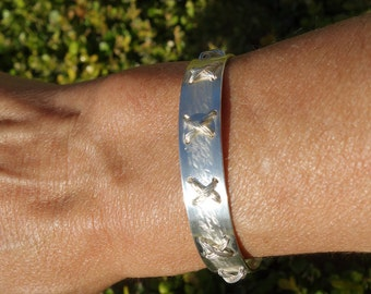 Handmade Sterling silver X bangle. Original design, each one is different.