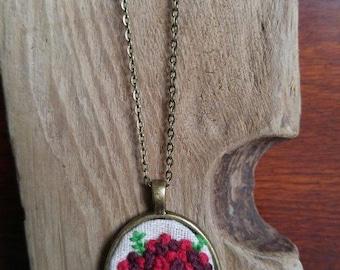 Handmade embroidery pendant.
