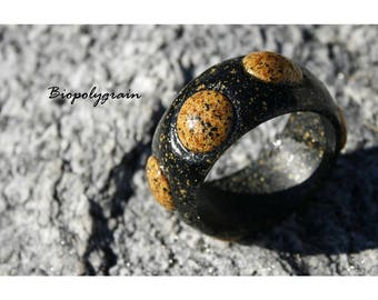 Rigid bracelet with stones