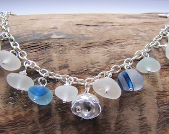 Sea glass charm bracelet with blue and white pebbles