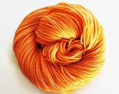 tangerine / hand dyed yarn / fingering sock dk bulky yarn / super wash merino wool yarn / single or ply / choose base / medium orange yarn